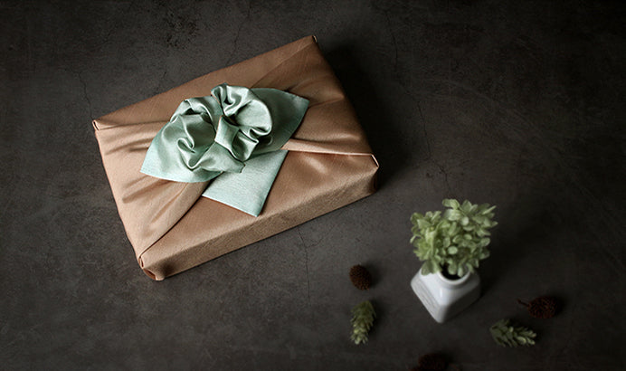 Any boy or girl will light up when they see this sea green and camel double sided Bojagi at their Doljanchi since it's luxury gift wrap.