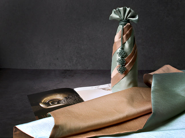 Awkward-shaped presents are no match for this moss and light brown Korean Bojagi, and it really brings a splendid look to anything wrapped in this fabric wrapping paper.