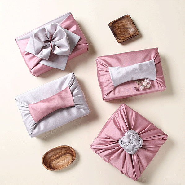 The rosy and slate colors look dreamy and this luxury gift wrap comes in multiple sizes.
