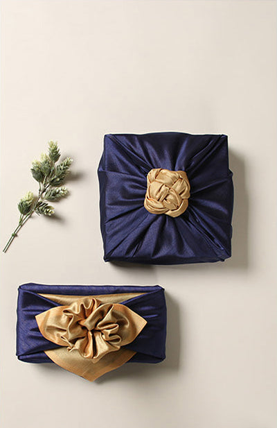 Add a bow to the top of the saxe blue and ivory Korean Bojagi gift wrapping cloth for a phenomenal ending to the gift.
