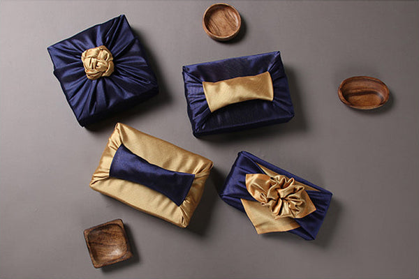 Wrapping presents with fabric is a blast if you're using the Bojagi art in dark blue and caramel.