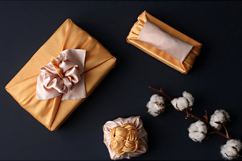 The one thing any party needs is a gift wrapped in this titian and straw gift wrapping cloth for maximum decadence.