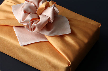 This reusable gift wrap in golden and bittersweet makes for an awesome choice to wrap presents with fabric.