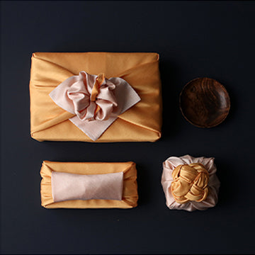We offer multiple sizes of Bojagi Korean wrapping for sale, such as this apricot and flaxen color, to fit any size or shaped gift.