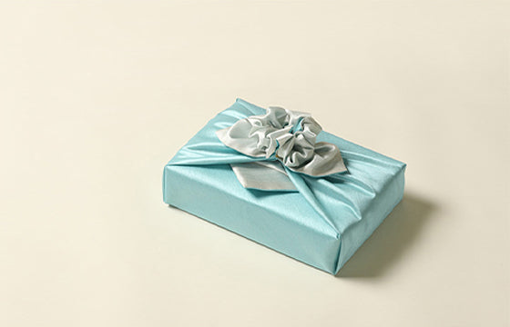 Teal and beige double sided Bojagi is a timeless look that will appeal to boys of all ages and is quite luxurious fabric gift wrapping to use for any formal event.