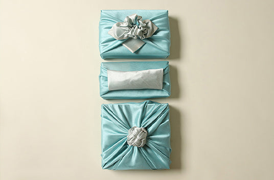 Azure and silver come together to create a fantastic look if you want to wrap presents with fabric cloth to make your present unique.