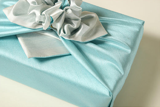 An up close look at the aquamarine and ash colored Korean Bojagi. Any man or woman would be thrilled to get a gift wrapped in this reusable gift wrap.