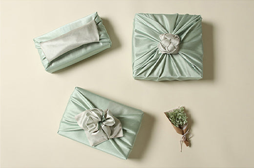 Sage and ash colored Bojagi Korean fabric wrapping is flawless and will work great for spring and summer gatherings.