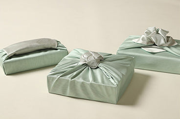 Purchase this greenish-blue and grayish Korean gift wrapping cloth Bojagi to captivate the audience anywhere you go.