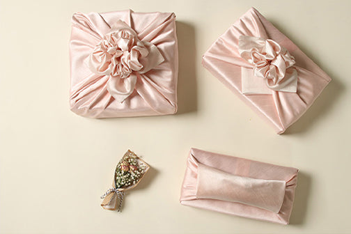 This fuchsia and light peach Korean gift wrapping cloth is ideal for spring birthdays and weddings. It's reusable gift wrapping that allows you to reverse the colors to fit the joyous event.