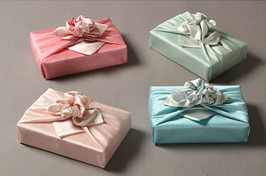 Light titian and peach luxury gift wrap will look amazing at a birthday party for a girl of any age.