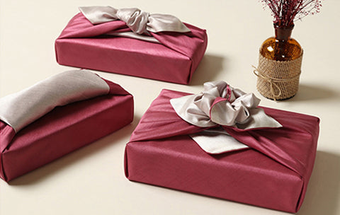 It doesn't matter what awkward shape the present is you can use the Bojagi gift cloth in cardinal red and slate to wrap any special item.