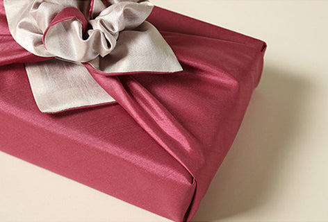 A close image of the crimson and pewter Korean gift wrapping cloth. It can be used during Seollal, Christmas, or other celebration since we have so many Bojagi for sale.
