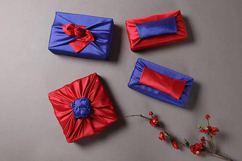 Shower someone special with love by giving them a gift with this fabric wrapping cloth in deep rose and neon blue.