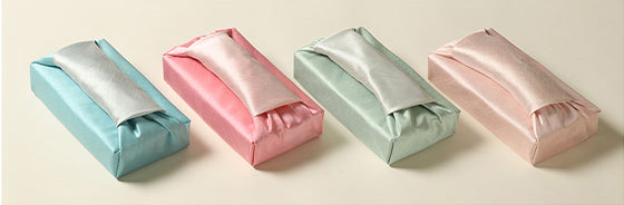 This picture shows just how attention-getting the scarlet and off-white Korean gift wrapping cloth looks.