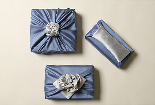 Indigo and sterling double sided fabric wrapping paper is the ultimate way to end any special gift for that love of your life.