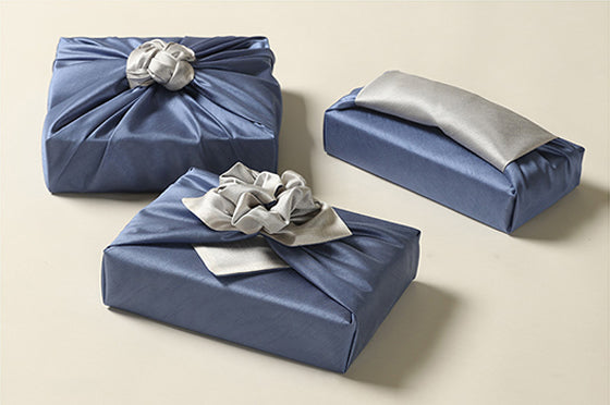 Take their breath away when you hand them a gift with this sapphire and peppery gift wrapping cloth.