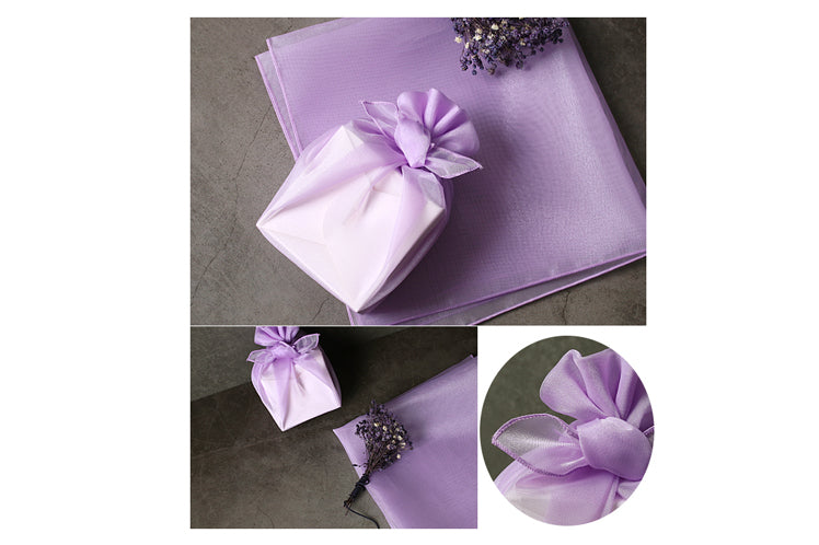 Ravishing bows on the periwinkle lucid Korean Bojagi wrapping cloth is a textbook example of opulence.