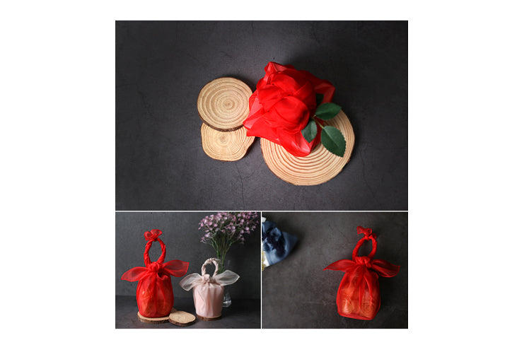 Give her a memento she'll remember forever by wrapping that present in this claret-red Korean wrapping cloth Bojagi.
