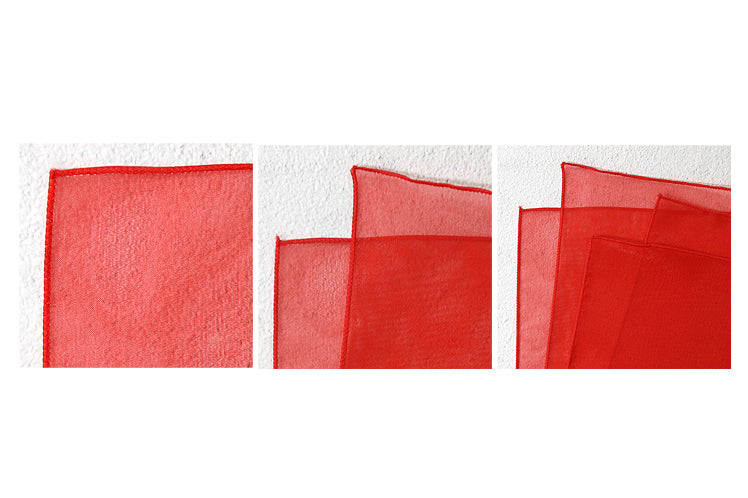 The cardinal red lucid Bojagi Art is sheer which makes it ideal for wrapping presents with fabric.