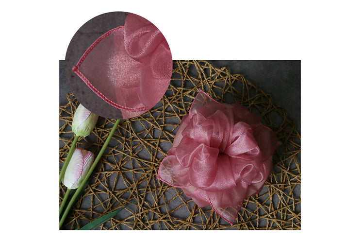 Pastel pink fabric wrapping is impressive and brings a soft touch to any gathering.