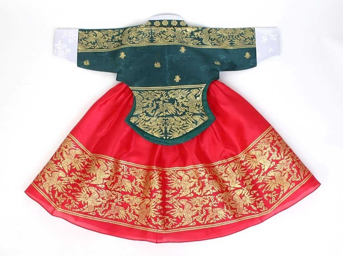 You can see in this image the detail and Korean elements that are put into the jade and dark red baby girl hanbok.