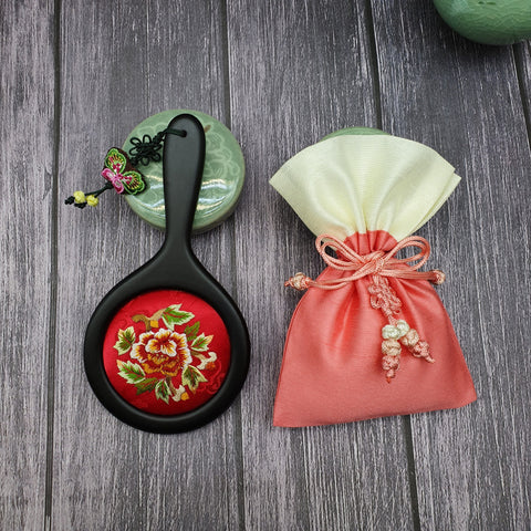The floral hand embroidered hand mirror that was traditionally used in Korea and is a favorite for many.