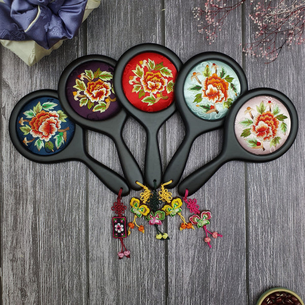 we provide a selection of 5 mirrors that all have a norigae tied at the bottom and a intricate floral design on the rear of the hand mirror.