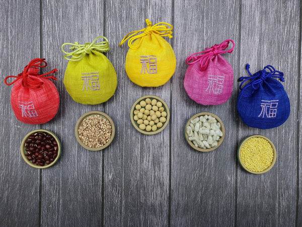 The rear of the prosperity pouches are embroidered with traditional Korean characters. This pouch makes it a friendly and welcoming Korean wedding gift.