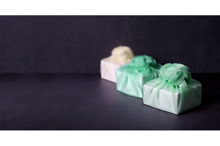 A breathtaking sight is when you sit your gift down on the table and it's dressed in this neon green Korean fabric wrapping.