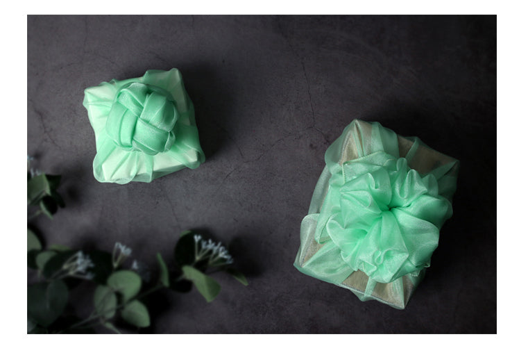 Small presents are quickly wrapped using this sea green lucid Korean Bojagi fabric.