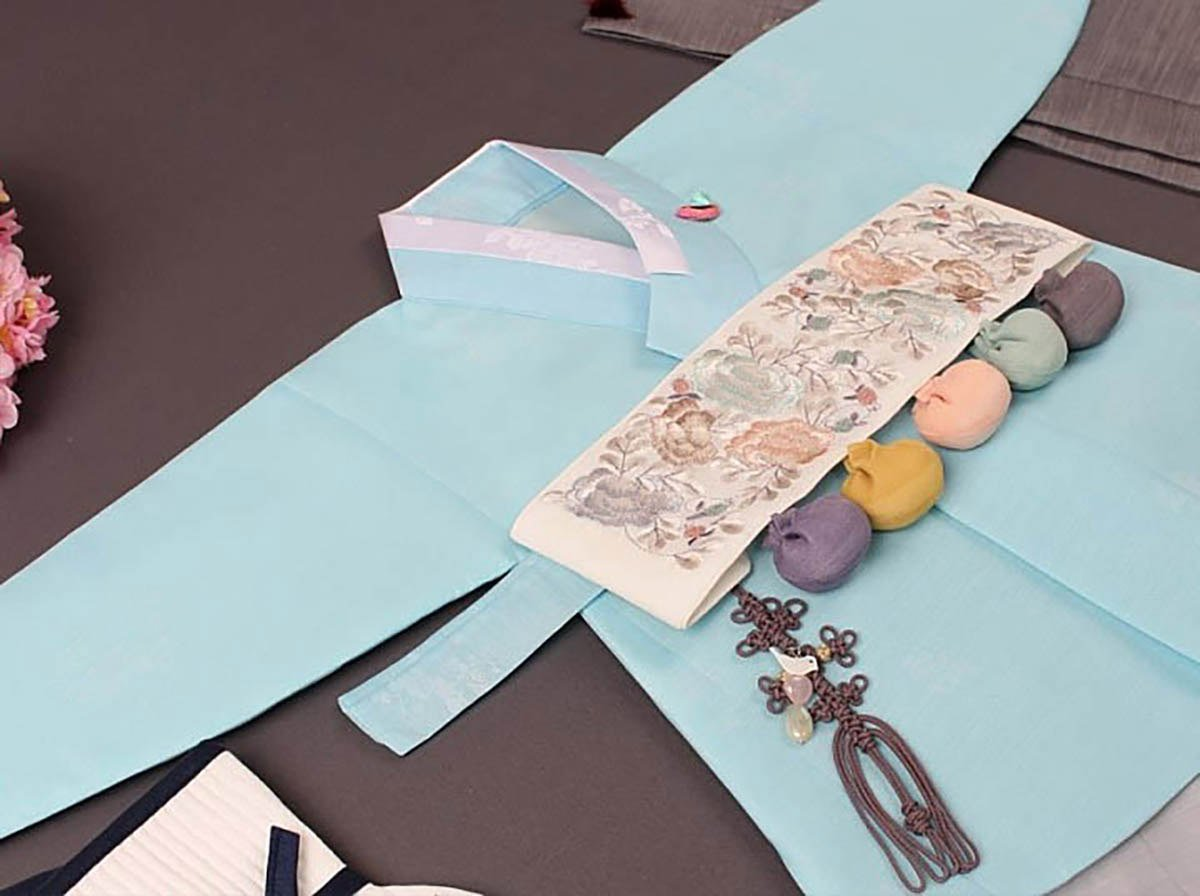 This image shows a better view of the entire baby boy hanbok in light blue and how it looks as a whole outfit.