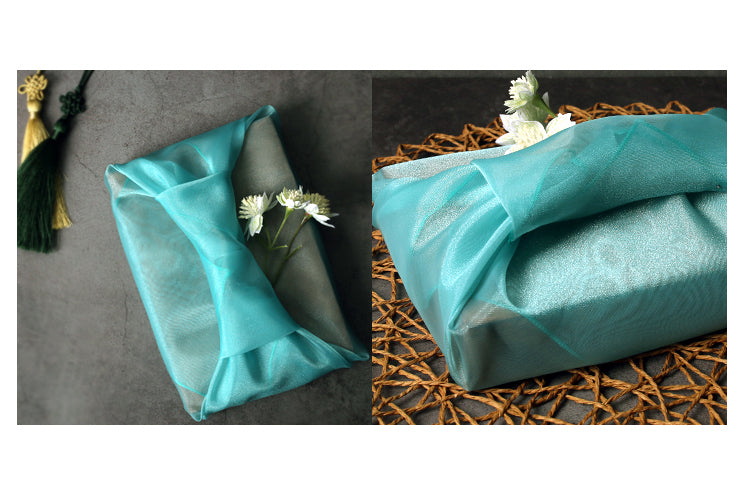 Azure lucid Bojagi is a trendy way to dress up any present given to a baby boy during his Doljanchi.