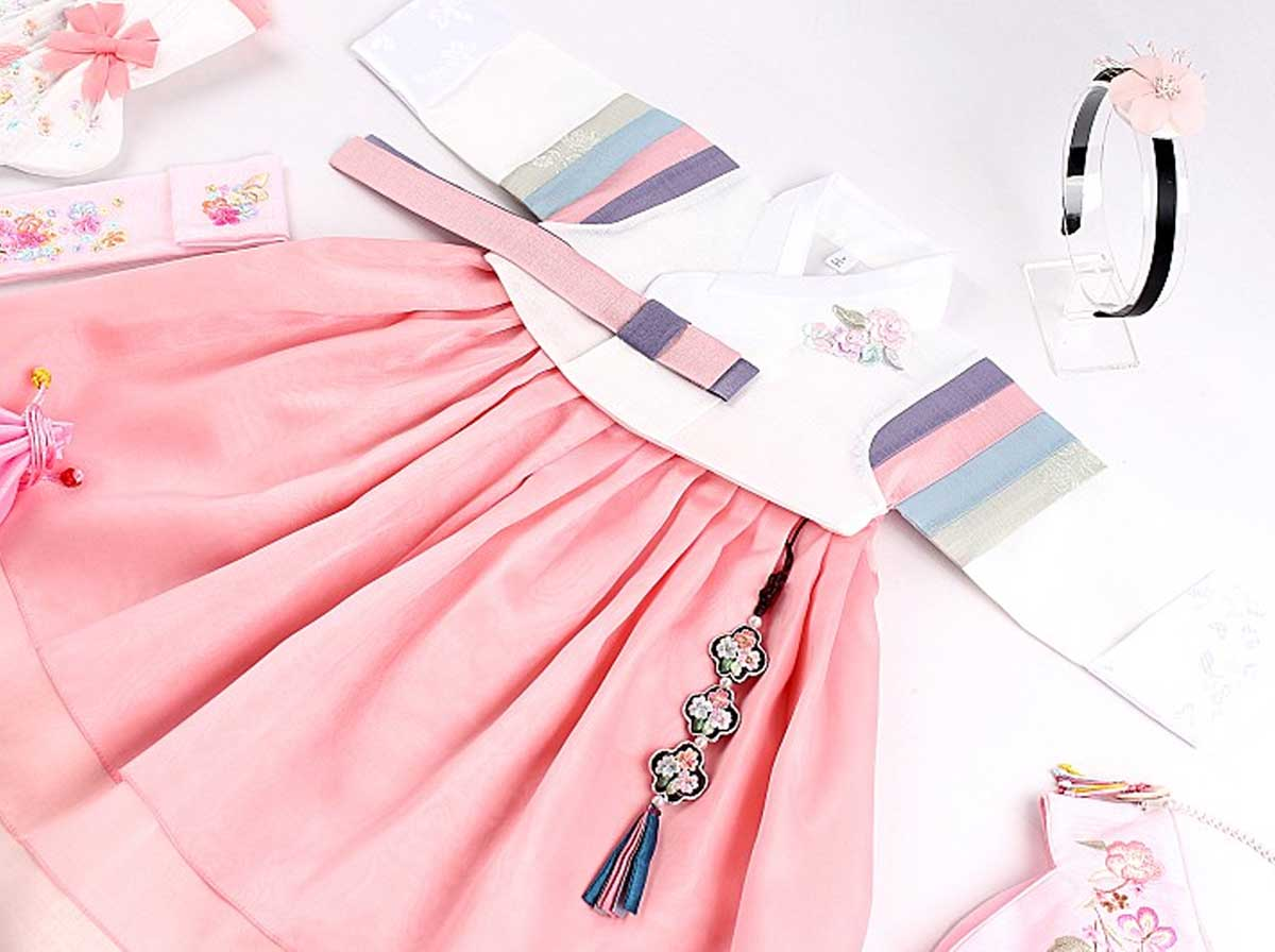 Here is a picture that shows what the blush and beige baby girl hanbok looks like as a complete outfit. Your baby girl will be smiling from ear-to-ear while she wears this outfit.