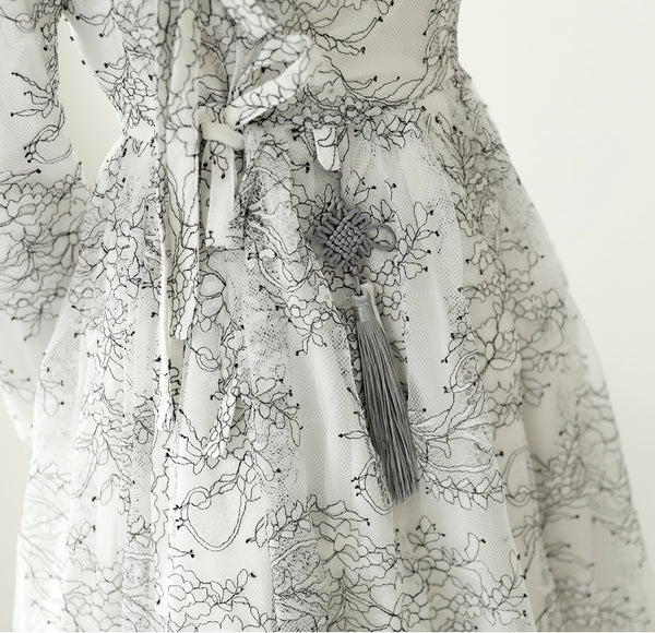 An up-close look at the jet black floral print on the ivory floral modern hanbok dress.