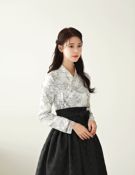 A charming and delightful way to add traditional Korean culture to your daily life is by wearing this rich white and charcoal floral modern hanbok dress.