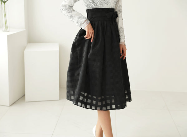 A perfect modern hanbok dress in chalk-white with dark black floral detail that goes well with even a pair of jeans.