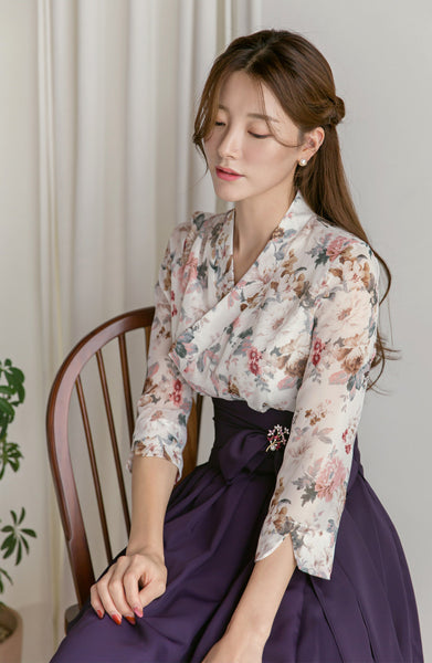 Add a hint of Korean culture into your wardrobe with the off-white flower modern hanbok dress.