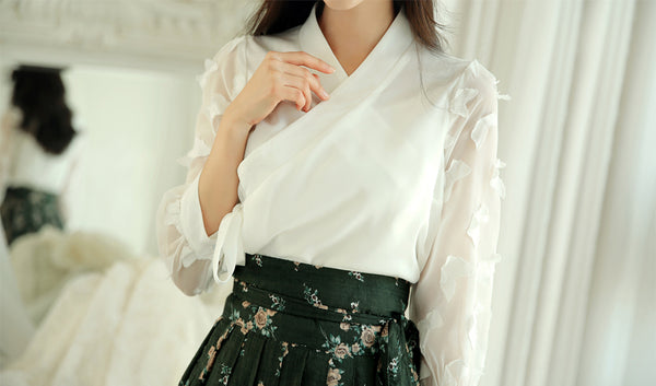 Impress everyone you see with this ivory butterfly modern hanbok blouse.