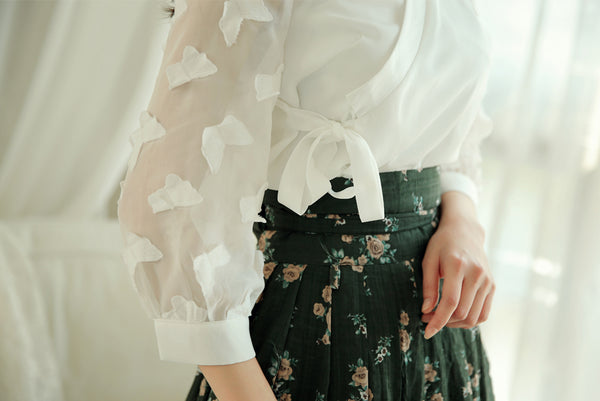 You can proudly wear Korean elements without a full hanbok with this deep ivory butterfly modern hanbok blouse.