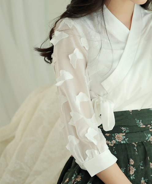 You can see the lovely butterfly details in this close-up picture of the alabaster modern hanbok blouse.