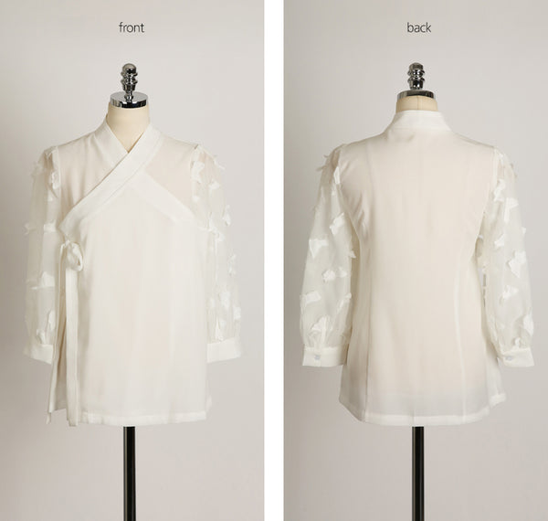 You'll see just how gorgeous this cream colored butterfly modern hanbok blouse is when you look at the full view.