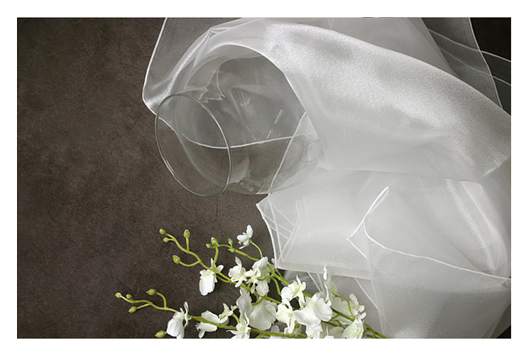 The chalky-white lucid Korean Bojagi is timeless if you're wrapping wedding presents with fabric.