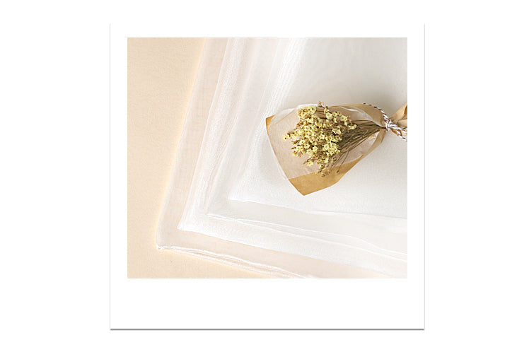 Use flowers and other items to decorate the outside of the beige lucid Korean wrapping cloth for even more appeal.