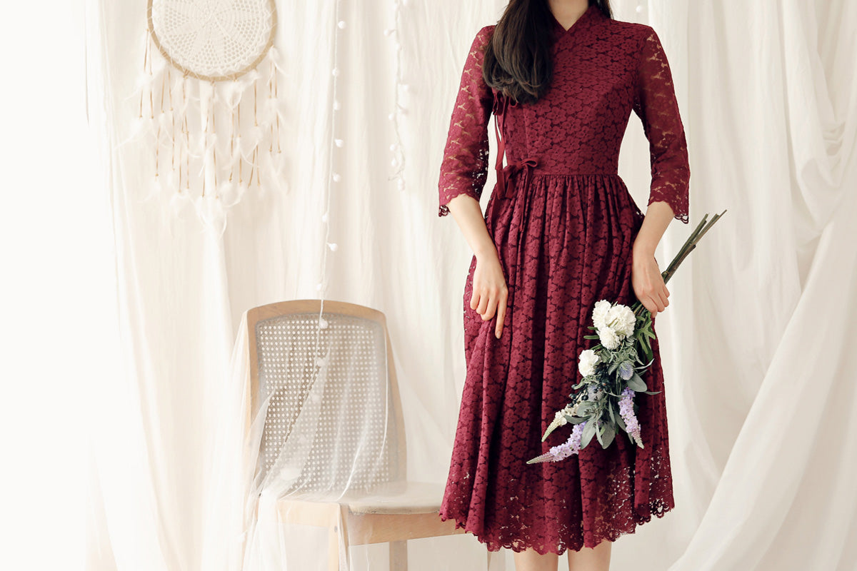 Feel comfortable and classy in this ruby red flower modern hanbok dress.