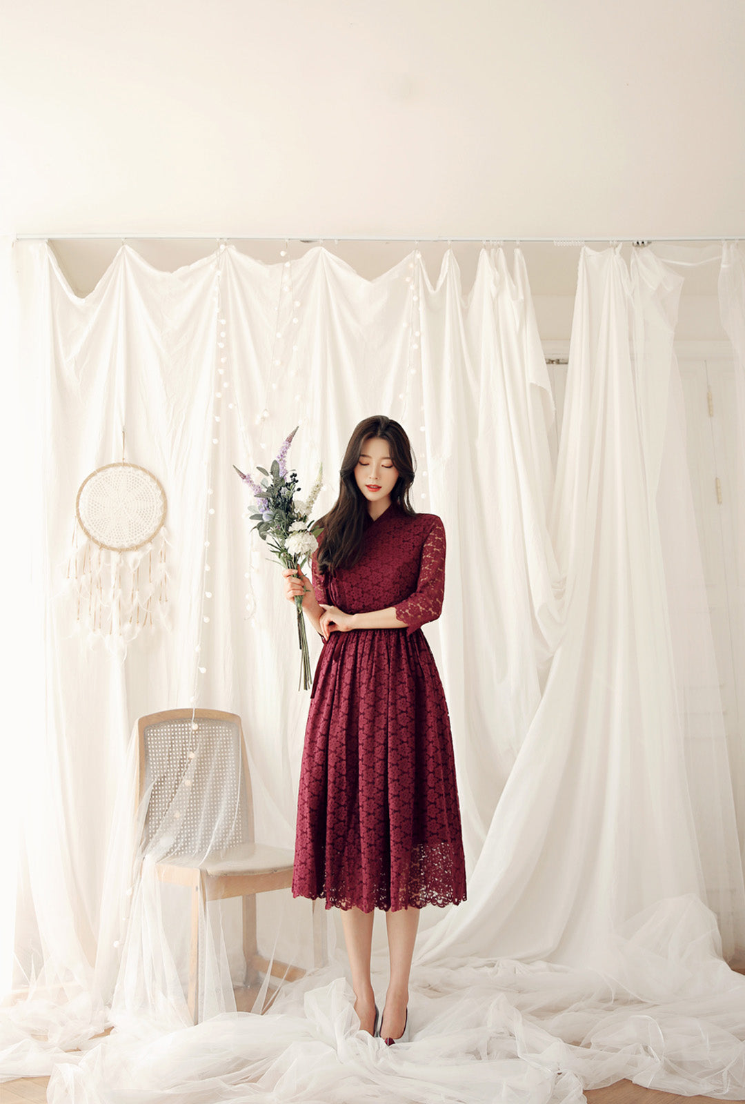 You'll feel the love from the world when people stop to compliment you in this brick-red flower modern hanbok dress.