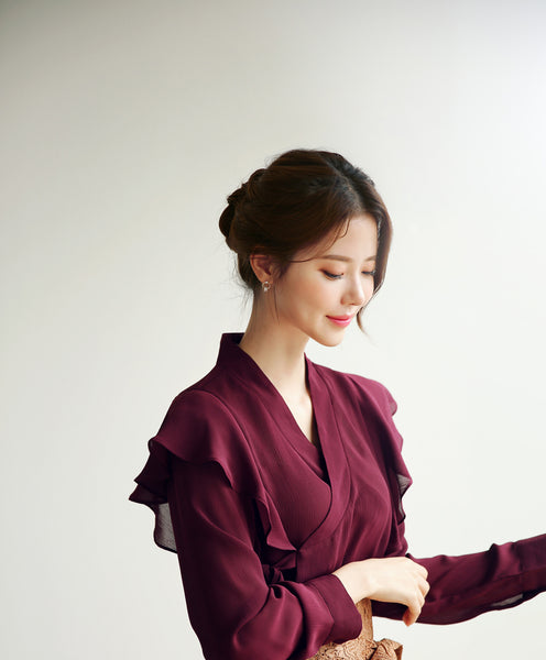 Feel like your proudly displaying your Korean history with this red frill modern hanbok blouse.