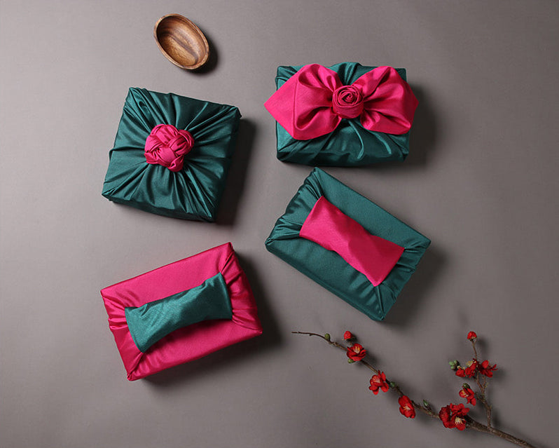Wrapping presents has never been easier using this sage and salmon Bojagi Korean fabric wrapping paper.