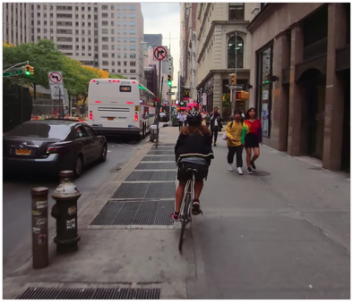Mesmerizing clip of a cyclist cutting through traffic in NYC