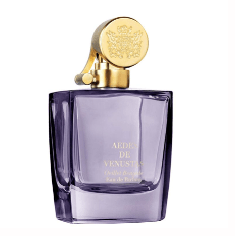 Light purple bottle with gold top. Aedes de Venustas Oeillet Bengale Eau de Parfum